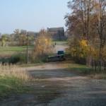 Czajkowice (ukr.Чайковичі). Widok od pałacu w kierunku kościoła użytkowanego jako spichlerz.